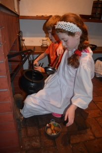 In Betsy Ross' cellar, you can do chores of the day, including cooking. We had to pull our two out of there.