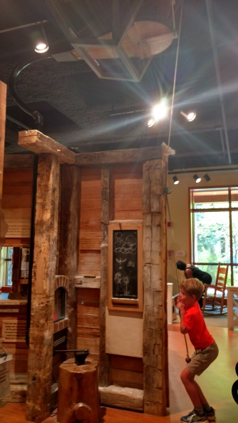 The children's museum area allows kids to try out some of the work done on the property, including making nails.
