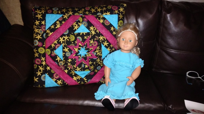 I bought this quillow (quilt tucked into a built-in pillow) and CQ bought this dress for her doll at an Amish store.