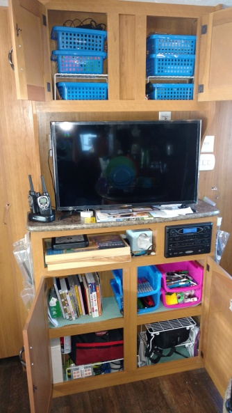 You can kind of see that on each side of this shelf, I have shoe holders. Those were for things needed as I went out the door - keys, sunglasses, sunblock, flashlight, etc. I attached them with small Command hooks. They were super handy!