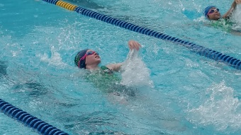 She loved swim meets and was eager to swim every chance they gave her!