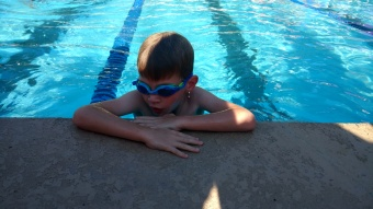 He only got up the courage to swim once during a swim meet, but he made it! And he learned a lot through the team!