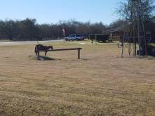 a medal statue of a horse at a hitching post